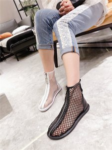 European-style summer water drill fishing net hollowed-out flat shoes short tube Martin boots locomotive front zipper fashion women's shoes