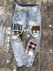 2020 sottili diritte dei jeans uomini strapparono denim jeans strappati locale notturno pantaloni da uomo primavera e autunno stretti blu di modo del cotone di H3