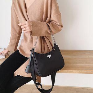 Взрыв женская новая нейлоновая сумка посыльного три в одном действии сумка мода кожаное плечо портативная сумка три части цветочные сумки bolsos
