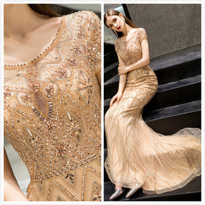 2019 Arabic Gold Luxurious Sexy Evening Dresses Beaded Mermaid Prom Dresses Cap Sleeves Formal Party Second Reception Gowns ZJ353