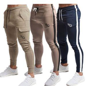 Pantaloni sportivi da uomo 2019 Nuovi pantaloni casual Abbigliamento da uomo di marca Pantaloni rossi lunghi di alta qualità Pantaloni elastici da uomo Pantaloni da jogging da uomo
