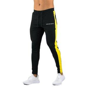 ENJPOWER nuevos hombres pantalones de Hip Hop ropa de la aptitud basculadores pantalón lateral raya de la manera clásica de Calle Pantalones deportivos Pantalones MX200323