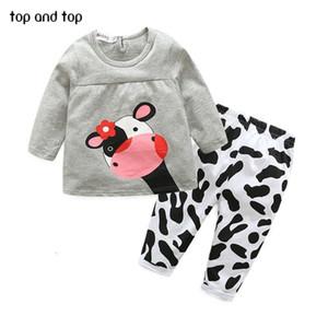 Toptan-kaliteli kış sıcak satış kız bebek giysileri gündelik uzun kollu tişört pantolon eşofman kız inek takım uyacak