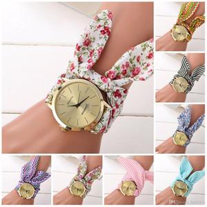 Relojes Pretty ladies flower cloth reloj de pulsera oro moda mujer vestido relojes de alta calidad reloj de tela dulce niñas mujeres vestido reloj