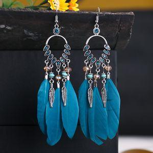 Bohemian new diamond-set rice beads feather earrings female long tassel earrings ethnic style