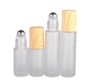 زجاجات زجاجية نظيفة ومجمدة دافئة قارورة حاويات بكرة دحرجة معدنية وقبعة من البلاستيك للحبوب الخشبية لعطر الزيت الأساسي 5ml 10ml