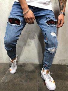 Lettre de broderie Printemps Skinny Pantalon bleu Crayon Hiphop rue Jeans Holes Washed Mens Designer Jeans