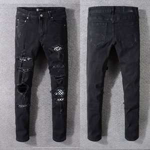 2020 designer high street tide brand AMIRI hip-hop jeans European and American Amiri splashed paint color washed hole embroidery black pants
