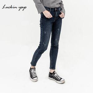 Лакиным йойо Женские джинсы Высокая талия Vintage рваные джинсы для женщин вскользь Тощий карандаш брюки Кнопка Ripped темно-синий