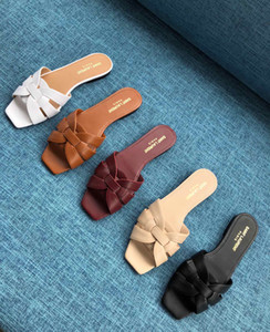 Venta caliente-2019 Alta calidad primavera nueva marca zapatillas sandalias planas de verano zapatos de playa de cuero mujer grande