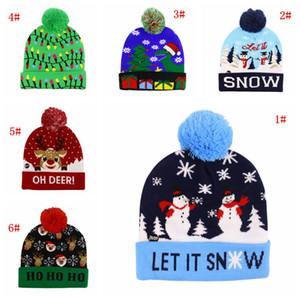 15 أنماط LED عيد الميلاد القبعة حزب عيد الميلاد تضيء قبعة قبعة سانتا كلوز إلك ثلج طباعة شتاء دافئ بوم بوم قبعات كاب DBC VT1217