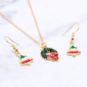 Lindos colgantes de collar de temática navideña para los niños favoritos Garland Cookie Bow colgantes con un par de aretes de árbol de navidad