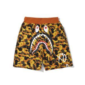 2020 2019 Nuevo adolescente Naranja Camo de playa pantalones cortos de los hombres de la marca Tide Hip Hop negro suelto Pantalones Pantalones cortos envío