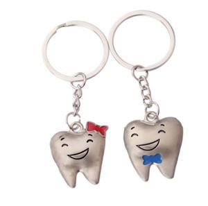 Venta al por mayor de dientes de dibujos animados llavero dentista 2 pcs = 1 par decoración llaveros modelo de diente de acero inoxidable Dental Clinic regalo