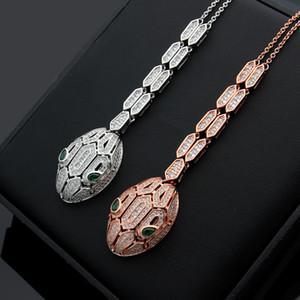 جديد وصول أزياء سيدة النحاس 18K مطلي بالذهب القلائد مع الماس الكامل الجوف خارج الأفعى رئيس قلادة أقراط 2 اللون
