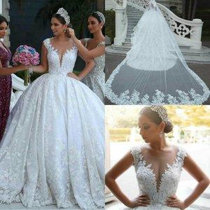 Luxury Arabic Wedding Dresses Plunging Neckline Lace Appliques Cap Sleeves Country Wedding Dress Custom Made Sweep Train Vestidos De Novia