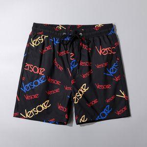 Pantalones 2019Wholesale verano forman los cortocircuitos nuevo diseñador de la tabla corta de secado rápido traje de baño de impresión de cartón playa de los hombres pone en cortocircuito para hombre