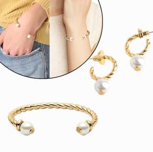 envío libre de la venta caliente plateada oro verdadero del perno prisionero de la perla pendientes Manguito anillo brazalete set.Hot sale.bangle letra de la manera Para las mujeres de la muchacha
