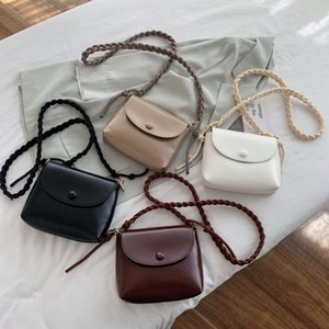 2020 new female bag shoulder bag hand-knitted strap shell oblique trans-ocean air button retro