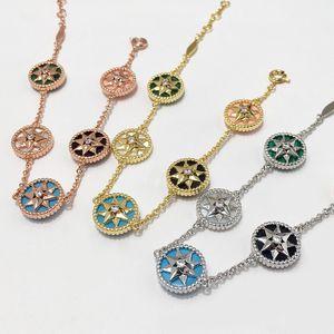 Trendy Fashion Trend gioielli di moda rosa d'argento Oro Lucky Compass Anice stellato del fiore della stella Braceletbangle per la donna