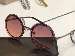Moda gafas de sol redondas de la cadena collar Sonnenbrille gafas de sol gafas de sol de las mujeres sin montura gafas de moda nuevo con la caja