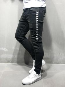 Painéis de Slim Pencil Pants Rua Hiphop Mens Calças Skinny longo Designer Mens Jeans Moda fita Buraco