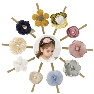 10 Farben Weihnachtsgeschenk Haarschmuck Baby Mädchen Stirnband Blumen-Design Bogen Stirnband Mädchenhaarzusätze 2 Stil