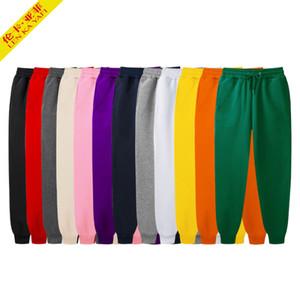 Sweatpants negro hombres de la moda 2020 nueva marca de color sólido blanco gruesos pantalones de color rosa otoño elástico en la cintura de los pantalones ocasionales flojos