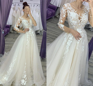 2019 Cheap Wedding Dresses Sheer Jewel Neck Lace Appliqued Long Sleeves Beach Bridal Gowns Sweep Train Boho Wedding Dress Plus Size