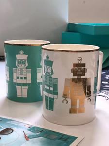 Mavi kahve süt bardak bir dizi Drinkware kupalar Robot mavi seramik fincan Düğün Hediyesi hediye kutusu ile kaliteli 2adet