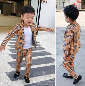 2019 Nuovi 2Pcs Ragazzi Plaid abito da sposa in Inghilterra ragazzi di stile di Gentleman Suit formale smoking Bambini Primavera insieme dei vestiti: coat + pants