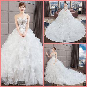 2019 livraison gratuite robe de mariée en organza à volants robe de mariée lourdement perlant scintillant bretelles chapelle train robes de mariée robe de mariée vente chaude