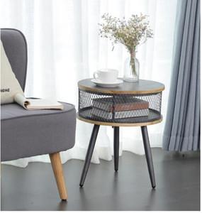 tavolo rotondo con deposito grigio accanto al divano nel salotto del paese americano in legno massello piccolo tavolo da tè ufficio famiglia