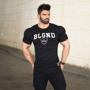 Estética muscular Bro Fitness Algodón Camiseta de manga corta con cuello redondo Slim Fit Camiseta de viento europea y americana