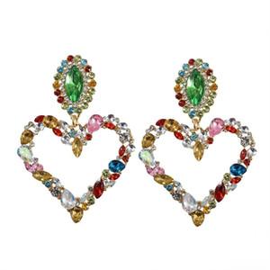 Dominada moda exagerada con la forma completa de cristal del corazón cuelgan aretes contratado joyería Joker largo pendientes de las mujeres