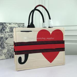 Сумки Сумки Кошельки Мода Полиграфический дизайн Письмо Sleek Cowhide неподдельной кожи сумки женщин пляжные сумки Холст Бесплатная доставка