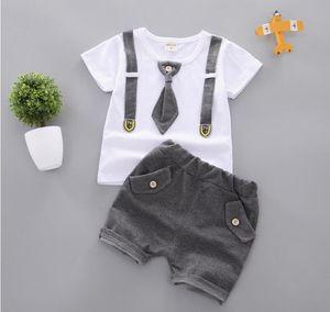 Cute Print T-shirt bianca + Bavaglino a righe Set due pezzi Baby Girl Girl Sets Regalo per bambini Regalo per bambini