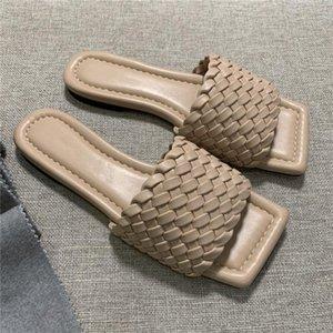 primavera nueva moda temprana de punto de verificación zapatillas de moda delgada y sandalias superficie de piel de oveja tejida con suela de cuero zapatillas
