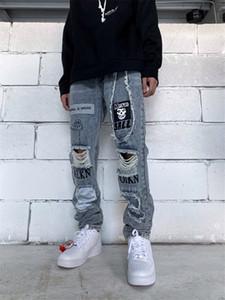 Mens Primavera Remendo Buraco Jeans letra impressa Applique Moda Masculina Calças reflexiva Zipper Sólidos Meninos Streetwears