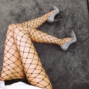 2019 pantalones de seda atractivo euro-americana Medias Sexy caliente perforado Big-acoplamiento de la red de pesca de fondo pantalones netos W49