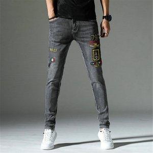 Jeans para hombre Daño de fundido Motocycle Jeans Para Hombres del diseño popular con paneles apenado de estiramiento de mezclilla flaca de los pantalones vaqueros rasgados