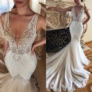 2020 Elegante arabische Vintage Meerjungfrau Brautkleider reizvolle tiefe V-Ansatz-Spitze-wulstige Brautkleider nach Maß Tulle Brautkleid