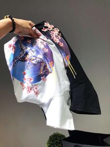 CLASSIC Hommes Designer T-shirts de luxe T-shirts avec la marque lettres couleur unie manches courtes Dinosaur Impression Femmes Casual Hauts Vêtements