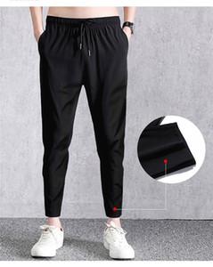 Mens secagem rápida Sweatpants soltas Sólidos Cor Designer Pants Stretch Homme Casual Calças Lace Up cortadas