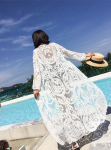 Utilizzare scialli ricamati femminili lungo cappotto sottile sulla spiaggia del mare è impedito di crogiolarsi in abiti che merletto cardigan costume da bagno