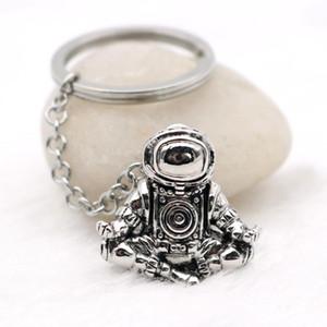 El astronauta llavero Galaxy Universo meditación del astronauta llaveros anillos de acero inoxidable Cadenas creativa personalizada coche Llavero