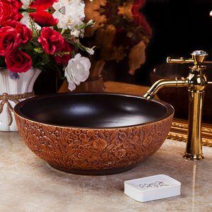 China Artistic Handmade Engraving Ceramic Lavobo Round Countertop wash basin ceramic