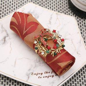 10шт Лидирующий Елка салфетку кольцо лук цветок венок рот кольцо отель образец набор номера стол Рождество салфетку пряжкой T200524