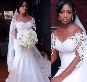 아프리카 플러스 크기 웨딩 드레스 깎아 지른 넥타이 3D 아플리케 환상 긴 소매 인어 웨딩 드레스 비즈 스팽글 조각 신부 드레스