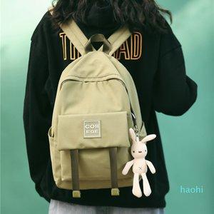 Designer-Backpack female 2020 new college student solid color schoolbag large capacity computer bag travel simple backpack.